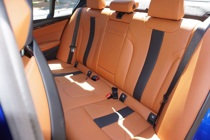 PORTLAND TRIBUNE: J EFF ZURSCHMEIDE - Three adults can ride in comfort and style in the back seats of the M5.