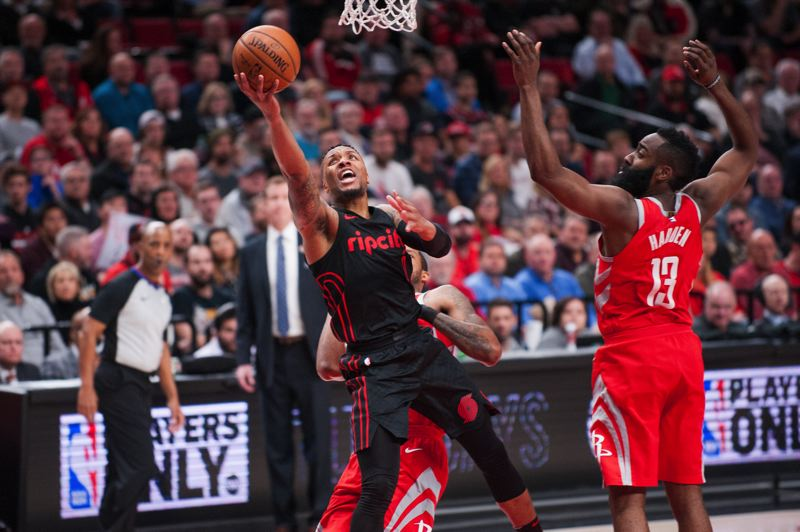 TRIBUNE FILE PHOTO: JOHN LARIVIERE  - Damian Lillard of the Trail Blazers drives on James Harden and the Houston Rockets.