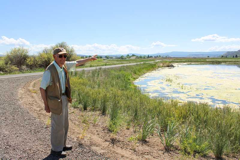 HOLLY SCHOLZ/CENTRAL OREGONIAN   - Crooked River Wetlands Complex Volunteer Docent Jim Van Vlack points out the horseshoe pond. As a docent, he greets, guides and interprets the wetlands to the many visitors and also helps with upkeep.