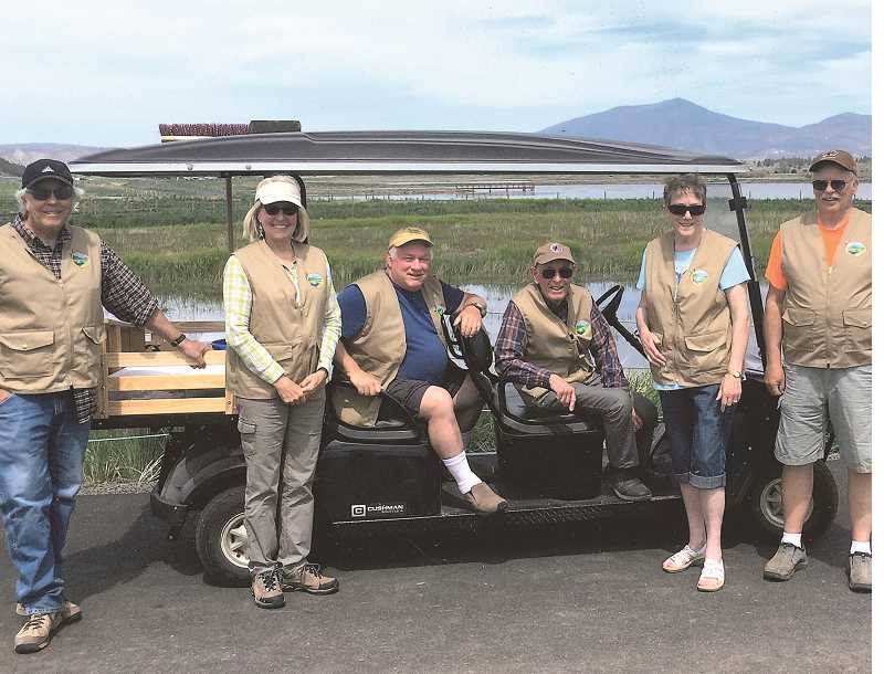 PHOTO COURTESY OF CITY OF PRINEVILLE  - The six volunteer docents pictured left to right with their cart: Ron Halvorson, Mary Ann Pogany, Chuck Gates, Jim Van Vlack, Sue Brittain and Jack Webb.