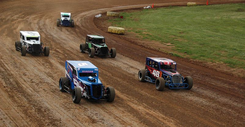 PHOTO BY MIKE WEBER - Teagan Fischer (center, No. 5), shown on May 5, won the May 19 Dwarf Car heat race 2.