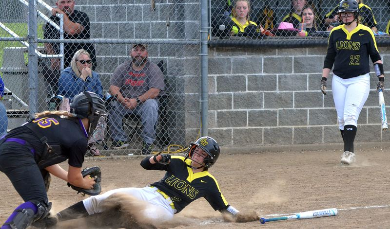 SPOTLIGHT PHOTO: JOHN BREWINGTON - St. Helens' Brooklyn Mercier is tagged out at home during her team's 10-5 Play-In game loss to Hermiston at St. Helens on Friday.