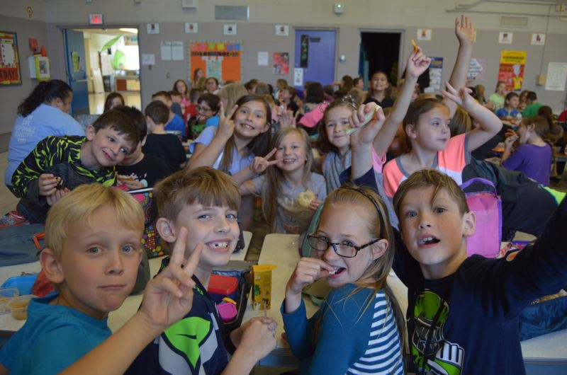 SPOTLIGHT PHOTO: NICOLE THILL-PACHECO - Lillia Erhardt, center, enjoys lunch with a group of her friends. Erhardt has donated $100 to Grant Watts Elementary School after recycling cans and bottles.