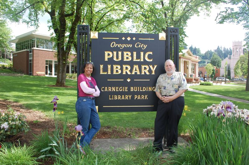 PHOTO BY: RAYMOND RENDLEMAN - McLoughlin Neighborhood Association Vice-Chair Denyse McGriff and Oregon City Library Board member Don Wright love the new sign.