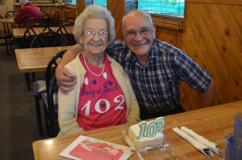SPOTLIGHT PHOTO: NICOLE THILL-PACHECO - Lillian Mickelson, left, poses for a photo with her friend and neighbor, Don Shimer, at Ichabods Resturaunt on May 17. Mickelson celebrated her 102nd birthday last week. Shimer, who is in his 80s, takes Mickelson out for her birthday every year.