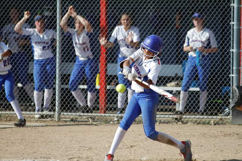 STAFF PHOTO: WADE EVANSON - Hilhi's Kiara McCrea takes a swing during the Spartans' state playoff game against Lebanon May 23, at Hillsboro High School.