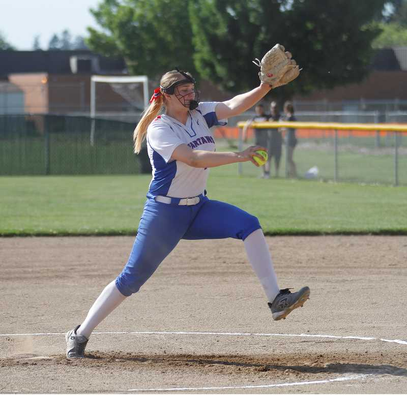 STAFF PHOTO: WADE EVANSON - Hilhi's Payton Goodrich throws a pitch during the Spartans' state playoff game against Lebanon May 23, at Hillsboro High School.