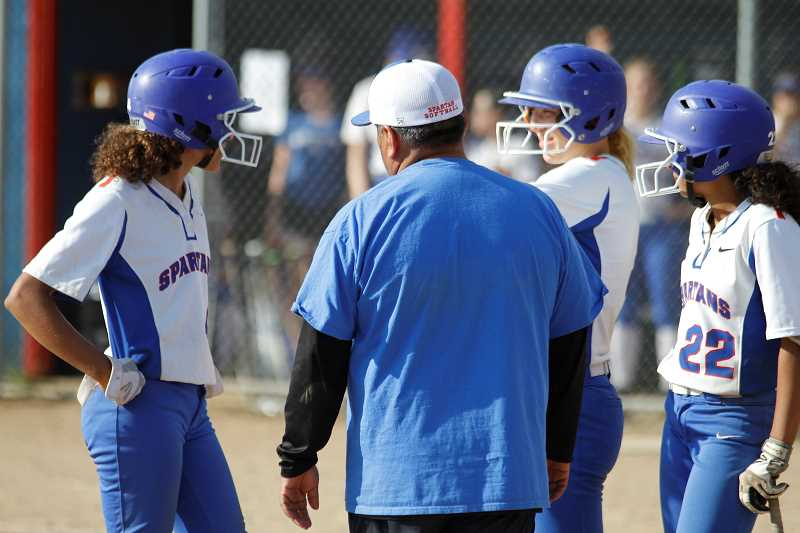 STAFF PHOTO: WADE EVANSON - Hilhi players huddle with assistant coach Pete Gonzalez during the Spartans' state playoff game against Lebanon May 23, at Hillsboro High School.
