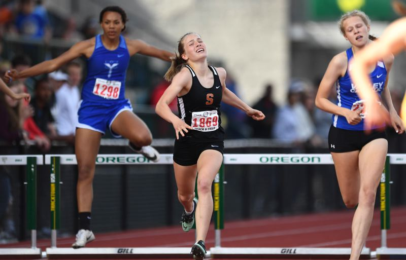 SPOTLIGHT PHOTO - Scappoose sophomore Emma Jones clears a hurdle on her way to finishing third in the 300-meter intermediate hurdles at the Class 4A state championship in the 1,500 meters at Hayward Field on Saturday.