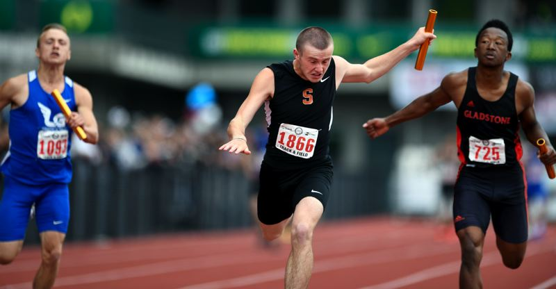 SPOTLIGHT PHOTO: CHRIS OERTELL - Scappoose sophomore Tyler Holcomb flies across the finish line to help his team win the 4 x 100-meter relay at the Class 4A state track meet at Hayward Field in Eugene on Saturday.
