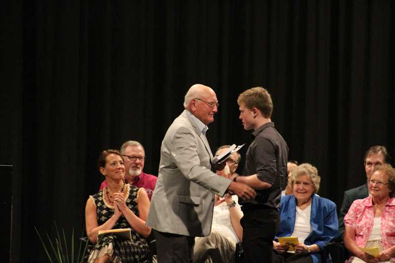 PIONEER PHOTO: KRISTEN WOHLERS - Bob Wendling presents Benjamin Pruitt with the Donna Wendling Memorial Scholarship.