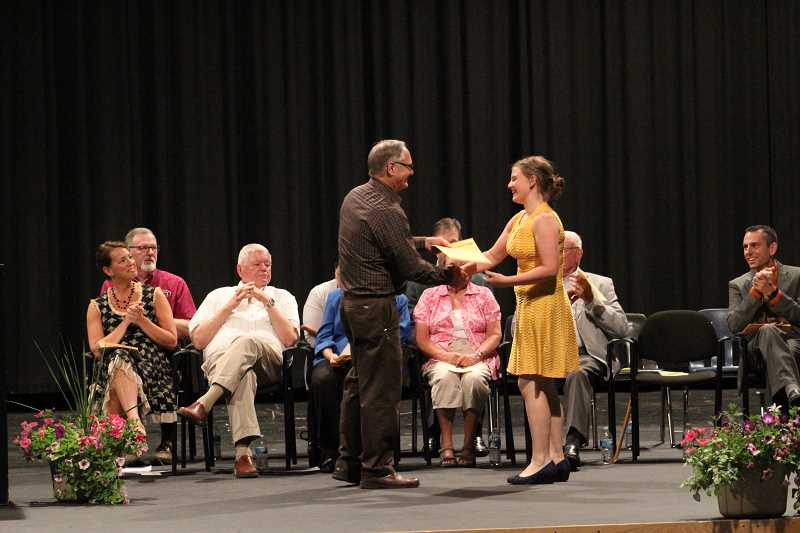 PIONEER PHOTO: KRISTEN WOHLERS - Halie McCloud receives a scholarship on May 23.
