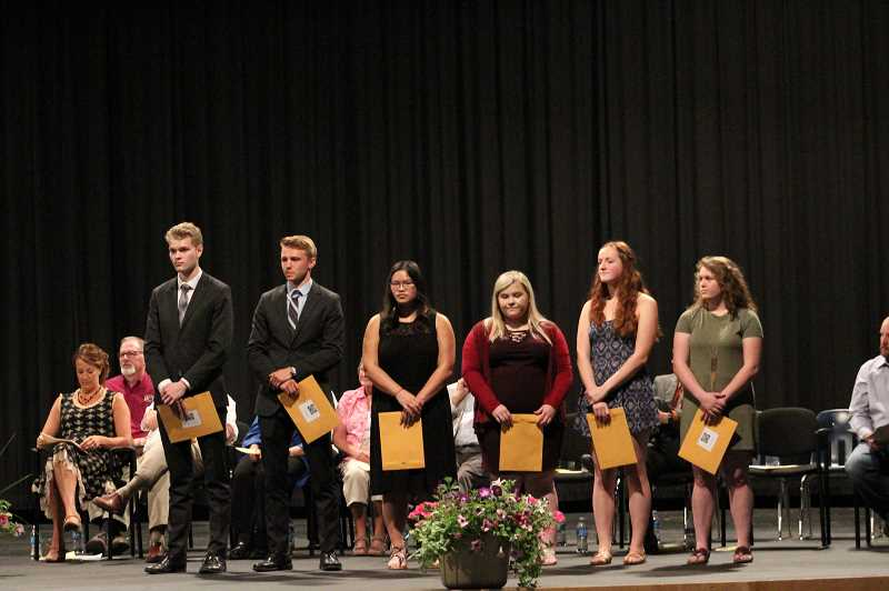 PIONEER PHOTO: KRISTEN WOHLERS - Receiving Share the Love Scholarships from left to right are: Gavin Barrett, Cole Bauge, Libby Byrne, Kassidy Stonehocker, Janiece Moore and Erin Swanson.