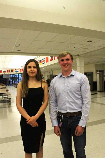 PIONEER PHOTO: KRISTEN WOHLERS - Valedictorian Irene Shvachka and Salutatorian Tyler Clark pause for a photo at the cake reception on May 23.