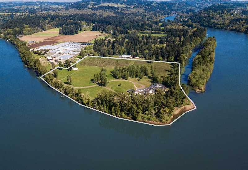 PHOTO COURTESY OF PLATINUM LUXURY AUCTIONS - The home's riverside parcel is considered its biggest asset, along with its proxmity to the shoreline, something not allowed in land-use rules today.