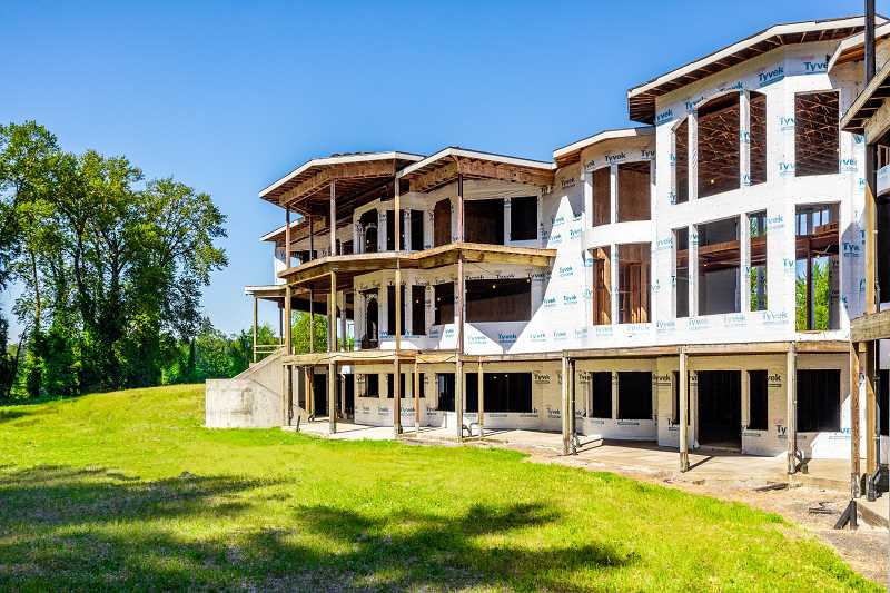 PHOTO COURTESY OF PLATINUM LUXURY AUCTIONS - Mark Wattles' original plans envisioned a sprawling, tri-level estate, with expansive views of the Willamette from nearly every room. He says that an active building permit means the structure can be completed as designed or modified to meet the new owner's needs.