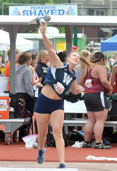 SPOKESMAN PHOTO: TANNER RUSS - Senior Sierra Bishop was another of the Wildcats top throwers to make it to the state meet. Woginrich and Bishop became friends when Woginrich moved to Wilsonville from Newberg.