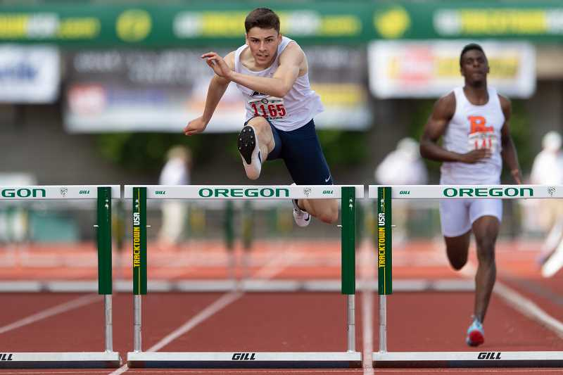 CHRISTOPHER OERTELL - Liberty's Aidan Maloney leaps over a hurdle during the 300m hurdles event at the OSAA 6A State Track and Field Championships May 18-19 at Hayward Field in Eugene.