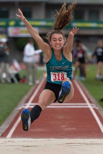 STAFF PHOTO: CHRISTOPHER OERTELL - Century's Nina Mastrantonio flies through the air during her triple jump at the OSAA 6A State Track and Field Championships May 18-19 at Hayward Field in Eugene.
