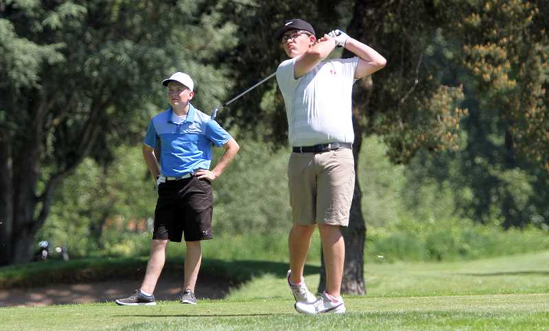 PMG FILE PHOTO: MILES VANCE - Glencoe's Casey Cameron watches his shot during the OSAA 6A State Golf Championships May 14-15 at Emerald Valley Golf Course in Creswell.