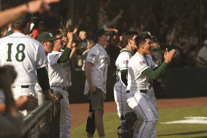 PHIL HAWKINS - The North Marion dugout erupts after senior Bryce Lemon's fifth-inning double brought in three runs to give the Huskies a 5-2 lead in the team's eventual 8-2 win over Crook County on Wednesday.