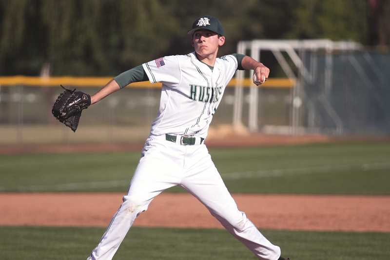 PHIL HAWKINS - Junior Griffin Henry worked the Cowboys from the mound, striking out 14 batters while allowing seven hits, two hit batters and a walk in six and two third innings.