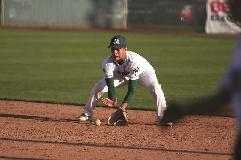 PHIL HAWKINS - Sophomore Sergio Jimenez fields a grounder to turn the final out in the Huskies' 8-2 win on Wednesday.