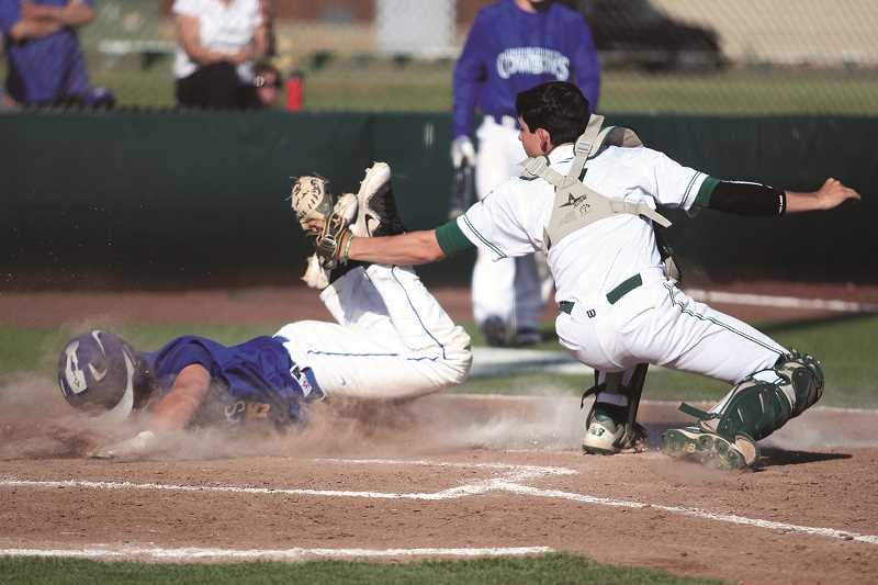 PHIL HAWKINS - Junior Grant Henry applies the tag to Crook County's Kyle Knudtson to prevent a run from scoring in the fourth inning.