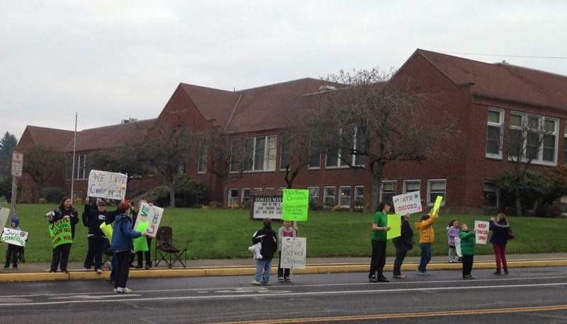 Community members rally to save Concord Elementary School before the North Clackamas School Board decided on its closure in 2013. Library supporters now hope the building will be saved.
