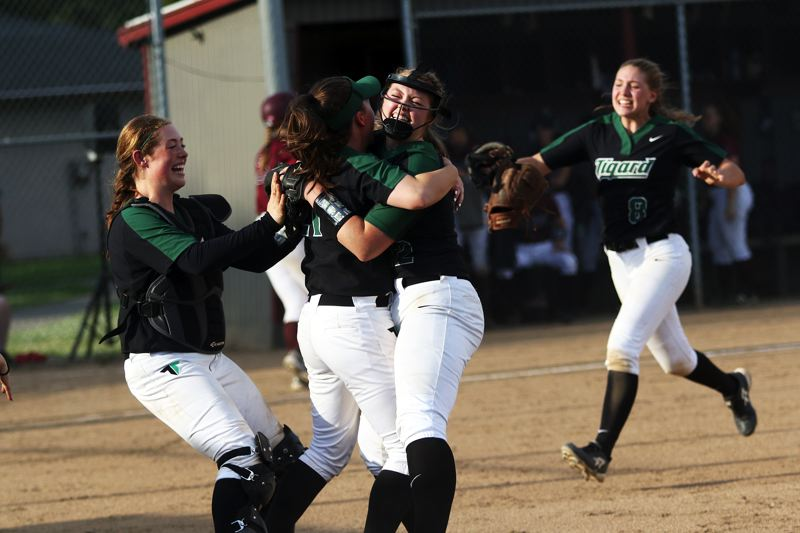 DAN BROOD - Tigard's (from left) Emily Paulson, Caroline Riggs, Ashley Davis and Abby Soderquist celebrate following the Tigers' 3-0 state playoff win at Glencoe.
