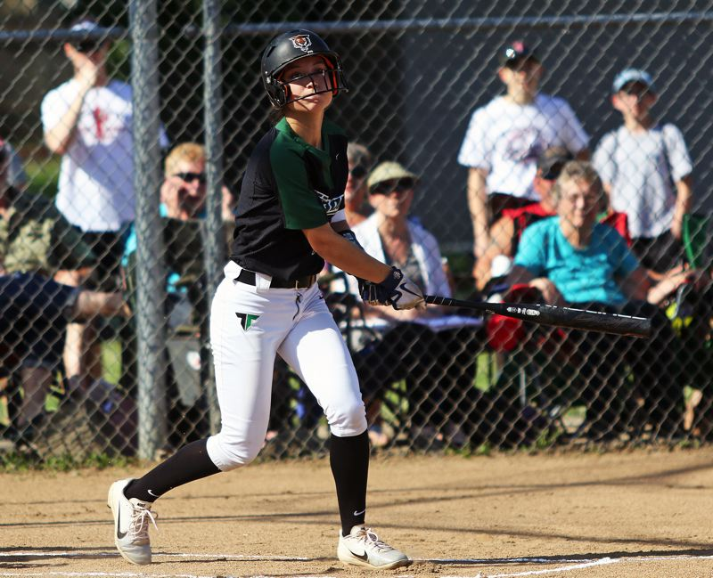 DAN BROOD - Tigard sophomore Lexi Klum takes a swing during the Tigers' win at Glencoe.