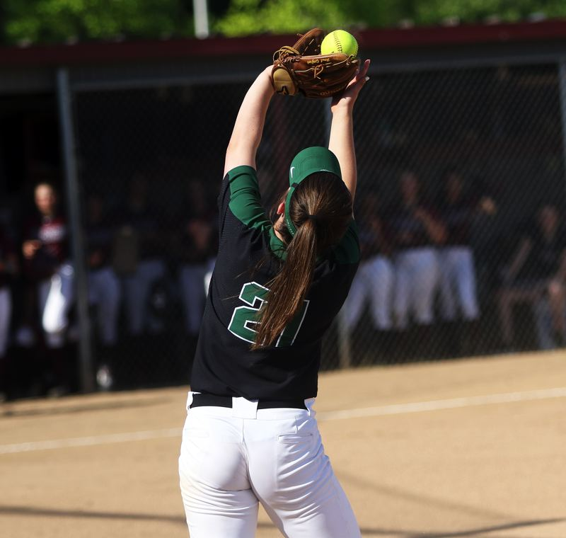 DAN BROOD - Tigard senior first baseman Caroline Riggs catches a foul ball during the Tigers' win at Glencoe.