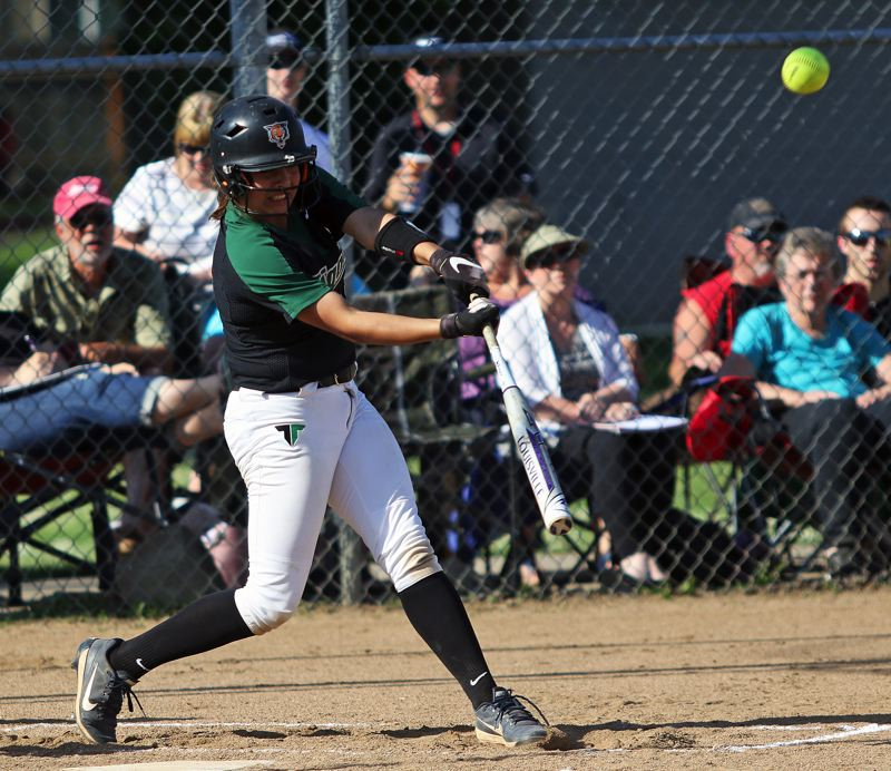 DAN BROOD - Tigard freshman Katie Regalado puts the ball in play during the Tigers' state playoff win at Glencoe.