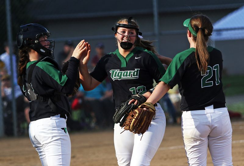 DAN BROOD - Tigard's Emily Paulson, Ashley Davis and Caroline Riggs celebrate an inning-ending out.