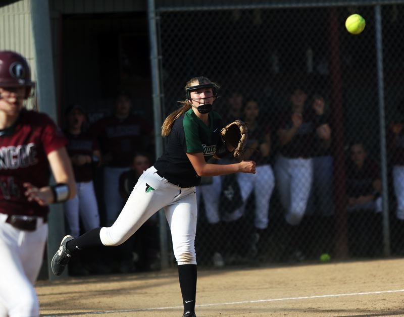 DAN BROOD - Tigard sophomore third baseman Abby Soderquist makes a throw to first after fielding a bunt in the Tigers' win at Glencoe.