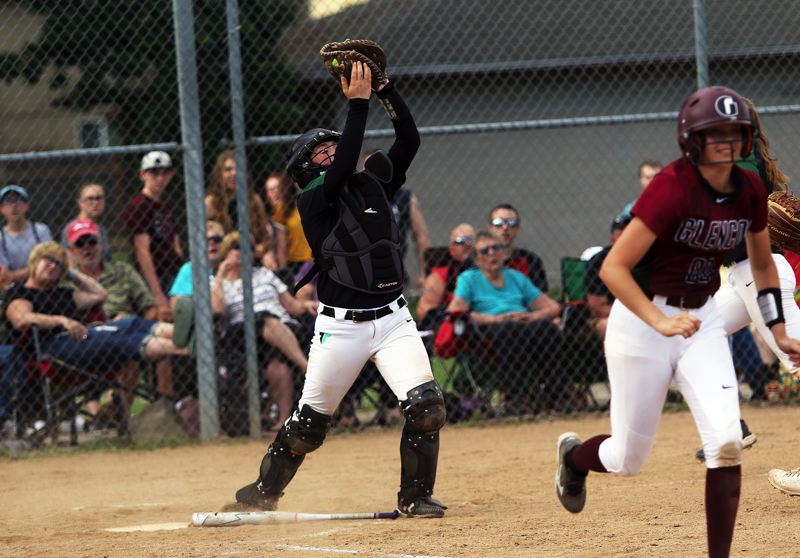 DAN BROOD - Tigard sophomore catcher Emily Paulson catches a popped-up bunt during the Tigers' win at Glencoe.