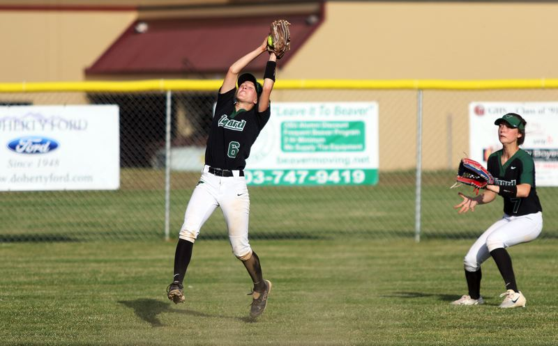 DAN BROOD - Tigard junior shortstop Maddie Hoover makes a leaping catch in the bottom of the seventh inning of the Tigers' 3-0 win at Glencoe.