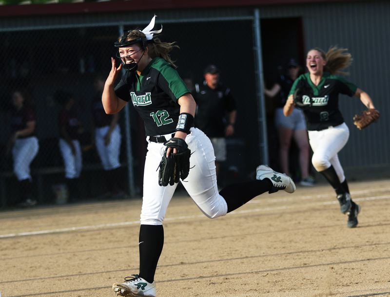 DAN BROOD - Tigard senior pitcher Ashley Davis runs toward her teammates following the final out of the Tigers' 3-0 state playoff win at Glencoe.