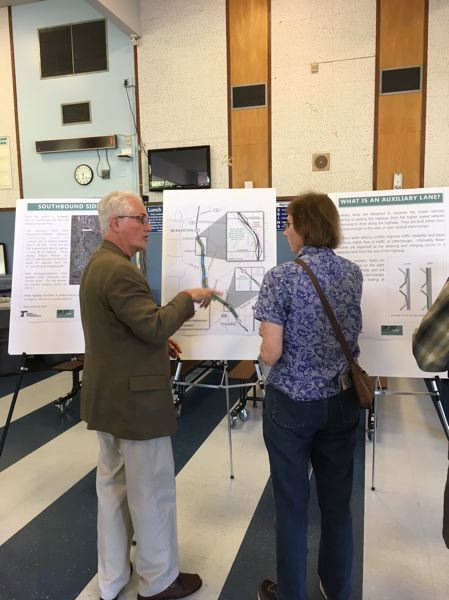 PAMPLIN MEDIA GROUP: PETER WONG - Metro Councilor Craig Dirksen, left, explains the features of the Highway 217 project for congestion relief during an open house May 23 at Whitford Middle School in Beaverton. Construction will get underway in 2020.