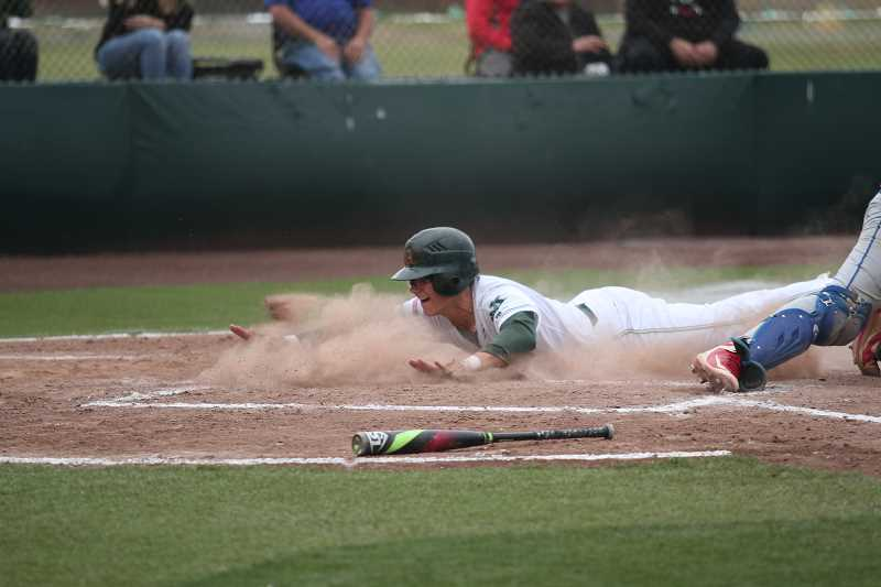 PHIL HAWKINS - North Marion senior Andy Schmitz slides home to give his team a 3-0 lead in the second inning. The Huskies would go on to score twice more in the fourth inning en route to a 5-0 win in the 4A State Quarterfinals against the Madras White Buffaloes.