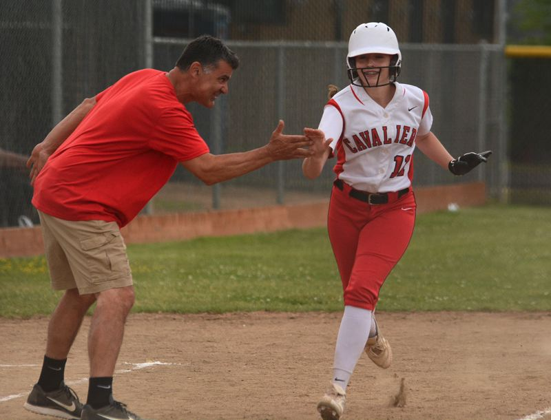 PAMPLIN MEDIA: DAVID BALL - Clackamas' Shaylee Monise gets a high five after hitting a homer over the center-field fence in the fourth inning.