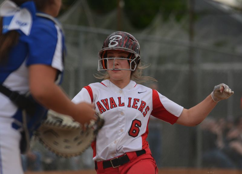 PAMPLIN MEDIA: DAVID BALL - Clackamas Kylie Hegar goes into her slide to score and put the Cavaliers up 3-1 in the third inning Friday.