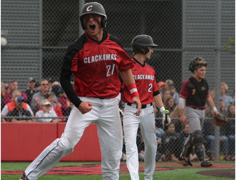 PAMPLIN MEDIA: DAVID BALL - Clackamas senior Greg Mehlhaff lets out a shout after scoring on a wild pitch for the go-ahead run in the third inning.