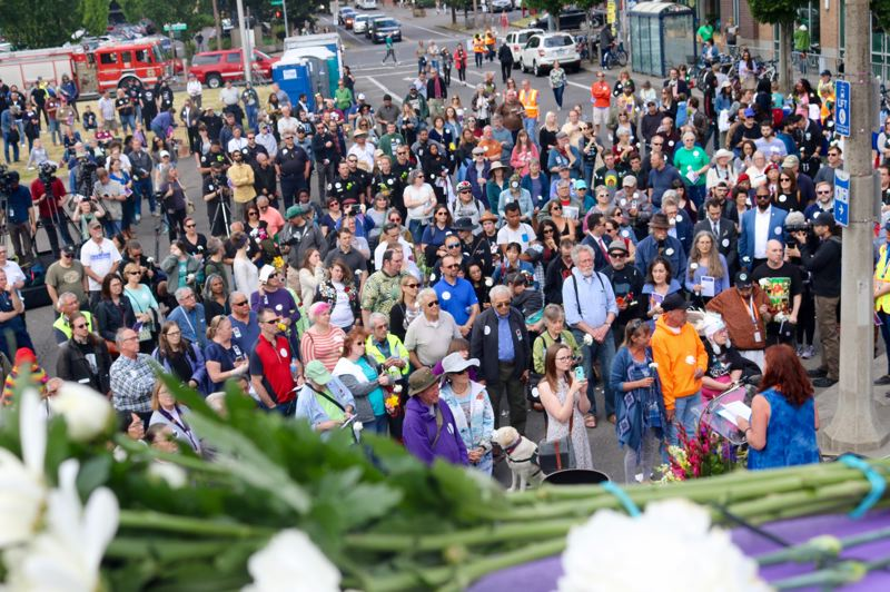 TRIBUNE PHOTO: ZANE SPARLING - A crowd begins to gather at the Hollywood Transit Center on Saturday, May 26, the one-year annivesary of the fatal MAX stabbing in Portland.
