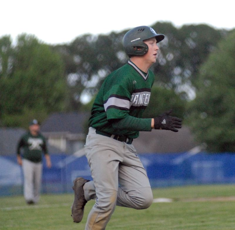 ESTACADA NEWS: MATT RAWLINGS - Dan Hunt runs out a ground ball in Estacada's game against Scappoose back on May 18.