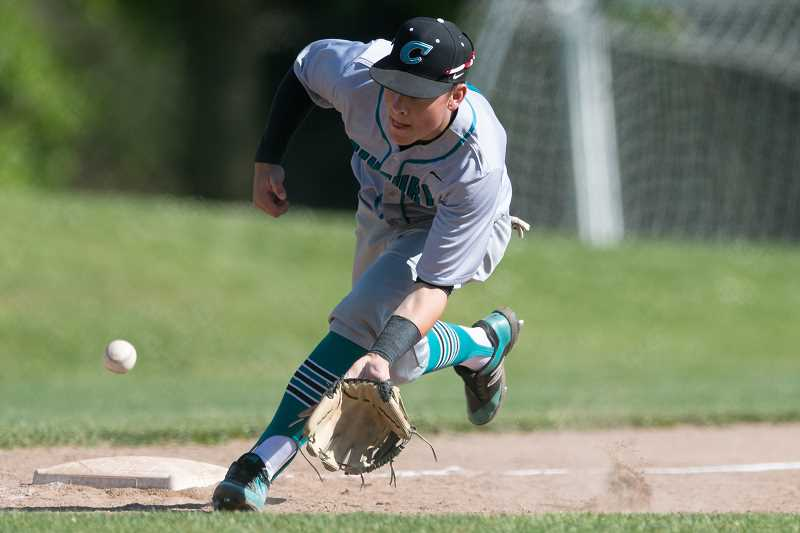 STAFF PHOTO: CHRISTOPHER OERTELL - Century's Justyn Herzog scoops up a ground ball during the Jaguars' first round playoff win over Lincoln May 23, at Gabriel Park in Portland.