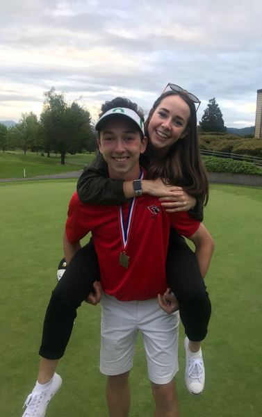 COURTESY: STEMBER FAMILY - Lincoln High's Nate Stember celebrates with sister Sara after winning the Class 6A boys golf championship.