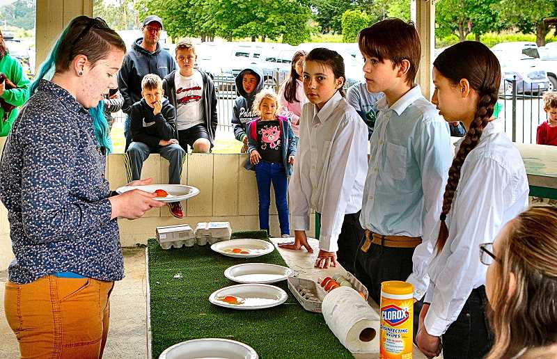 DAVID F. ASHTON - In 4-H shows, the egg is judged before the chicken is.