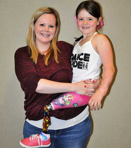 PHOTO: BLAIR STENVICK - Ashley Graber holds her daughter Malea Fox, 7. DX Share Life is raising funds for a Rifton Bike for Malea and a larger car for Ashley.