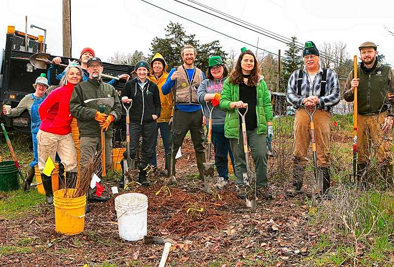 DAVID F. ASHTON - With some seventy-five plants installed, the volunteer group gathers for a team photo.